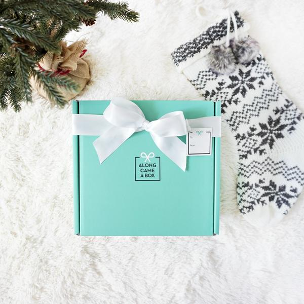 http://alongcameabox.com/collections/gift-boxes/products/pretty-in-pink-full-day-holiday
